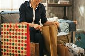 Closeup On Happy Young Woman With Shopping Bags In Loft Apartmen