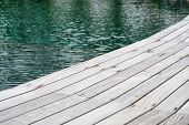 Close Up of Swimming Pool Surrounded by Wooden Decking