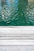 Close Up of Edge Wooden Decking Surrounding Swimming Pool