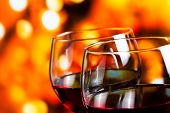 Two Red Wine Glasses Against Colorful Unfocused Lights Background