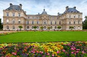 Palace And Flowers Of The Luxembourg Garden In Paris