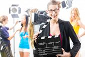 Woman with take clap or board on Film Set of video production for TV, television, news or commercial