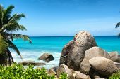 Large Rocks on Beautiful Beach with Turquoise Color Water at Anse Machabee in Mahe Island, Seychelles. An Enchanting Tourist Destination for Vacations. poster