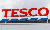 Tesco supermarket sign with logo and branding