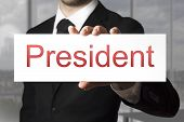 Businessman Holding Sign President