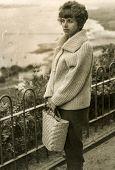 LODZ, POLAND, CIRCA SIXTIES - Vintage photo of woman with a big handbag