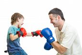 kid boy and father play boxing