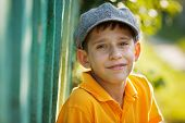 pic of debonair  - Happy boy in a gray woolen cap - JPG