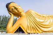 Reclining golden Buddha  statue at Phuket, Thailand