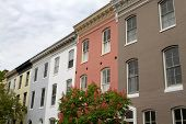 picture of soffit  - Multicolored row houses with a decorative soffit against a cloudy sky in Baltimore Maryland - JPG