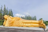 stock photo of recliner  - Reclining Buddha gold statue at Srisoonthorm temple Phuket - JPG