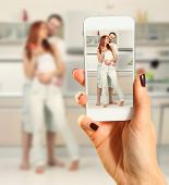 Hands talking photo of beautiful couple with smartphone