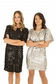 Two Woman Stand Next To Each Other Shiny Dresses