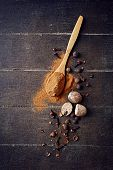 Assorted natural spices on wooden background