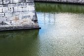 city wall and moat with ripples