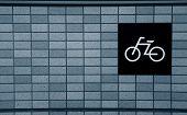 Symbol on the brick wall showing biking trail