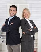 Successful male and female business team: senior and junior managing director.