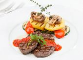 Grilled steak with baked vegetables