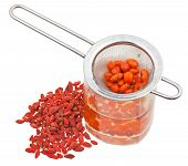 Strainer In Goji Berries Infusion And Dried Fruits
