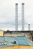 Chimneys Of District Heating Over Urban Roofs