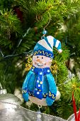 christmas snowman decoration on tree background