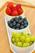 Blueberries, strawberries and grapes in cans