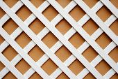 Closeup of a wooden grating painted white.