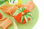 image of smoked salmon slices on green
