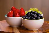 Blueberries, strawberries and grapes in bowls