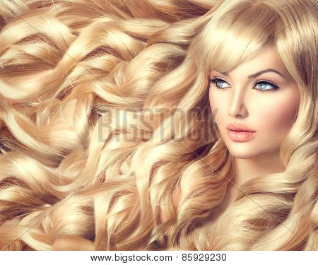 Beauty Blonde Woman Portrait. Beautiful model girl with long curly blond hair. Hairdressing, hairsty