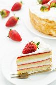 stock photo of cream cake  - cake with cream and strawberries on a white background - JPG