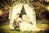 picture of wedding arch  - Charming elegant bride under the wedding arch - JPG