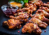 picture of chicken wings  - BBQ chicken wings with spices and dips - JPG