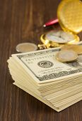 stock photo of money prize  - dollars money banknotes on wooden background - JPG