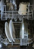 stock photo of dishwasher  - Dishwasher from inside with some plates and a mug - JPG