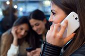 pic of cafe  - Portrait of three young woman using mobile phone at cafe shop - JPG