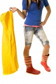 stock photo of woman boots  - a woman in her rain boots holding on to her raincoat - JPG