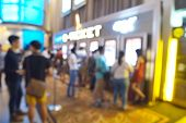 picture of time machine  - Blur or Defocus image of People line up to buy Movie Ticket from e - JPG