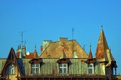 stock photo of attic  - The windows in the attic of the building in Poznan - JPG