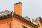 pic of roofs  - chimney on the roof of the house against the blue sky - JPG