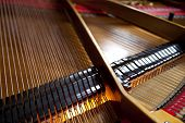 stock photo of grand piano  - Details and ropes of a grand piano - JPG