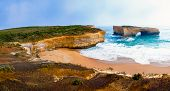 stock photo of 12 apostles  - London Bridge at The Twelve Apostles a famous collection of limestone stacks off the shore of the Port Campbell National Park by the Great Ocean Road in Victoria Australia - JPG