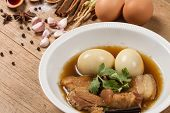 """foto of pork  - """"eggs and pork stewed in the gravy"""" or """" eggs and pork in brown sauce"""" are the traditional thai food style. - JPG"""