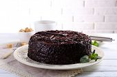 pic of tort  - Tasty chocolate cake with mint on table close up - JPG