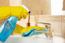 foto of detergent  - woman in rubber gloves with rag and detergent cleaning the bathroom - JPG