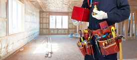 foto of handyman  - Builder handyman with construction tools - JPG