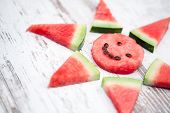 image of watermelon slices  - Sun made from slices watermelon - JPG