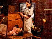 image of panchakarma  - Man having Ayurvedic sauna treatment - JPG