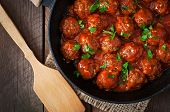 stock photo of meatball  - Meatballs in sweet and sour tomato sauce on table - JPG