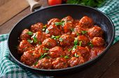 picture of meatball  - Meatballs in sweet and sour tomato sauce on table - JPG